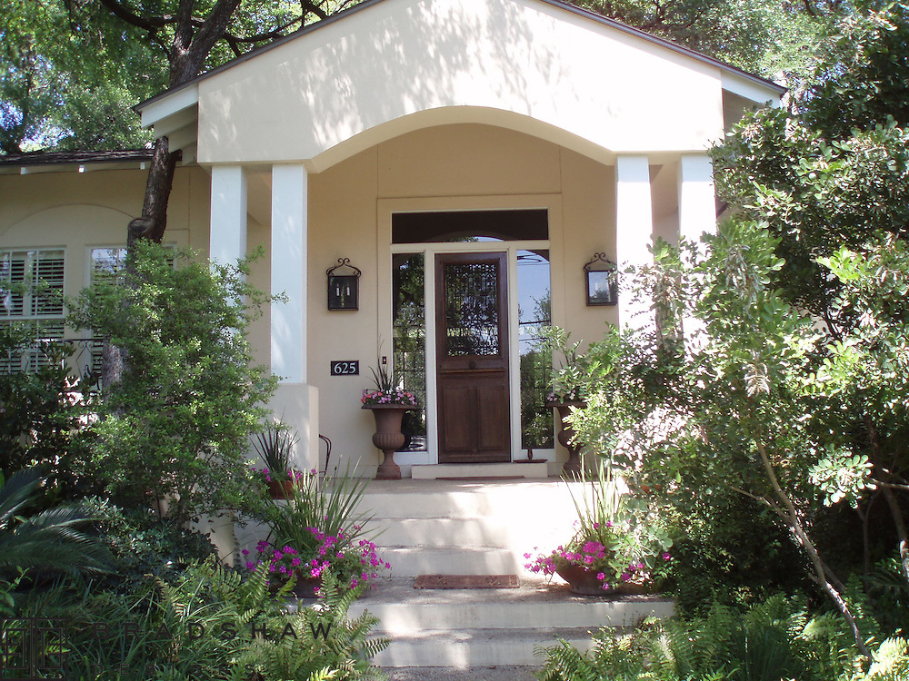 Antique French Doors and Copper Gas Lanterns add character to a charming Alamo Heights home in San Antonio.