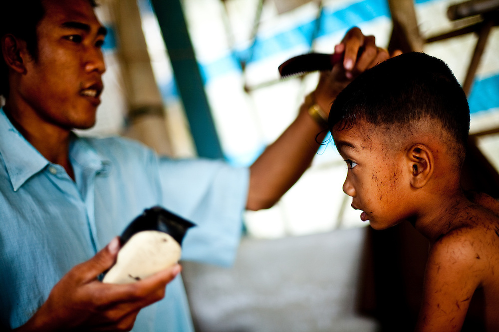 A ethnic Khmer boy gets a haircut in Tra Vinh, Vietnam.