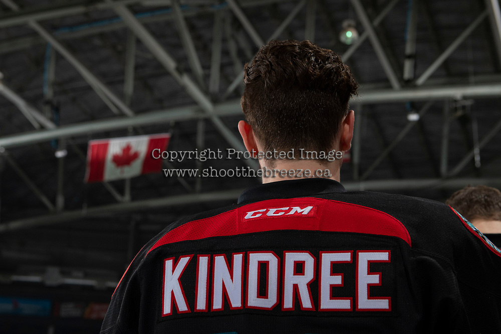 KELOWNA, CANADA - DECEMBER 5:  Liam Kindree #26 of the Kelowna Rockets stands on the bench against the Tri-City Americans on December 5, 2018 at Prospera Place in Kelowna, British Columbia, Canada.  (Photo by Marissa Baecker/Shoot the Breeze)