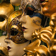 Handmade and hand painted paper mache Mardi Gras masks displayed in mask maker's shop, Venice, Italy<br />