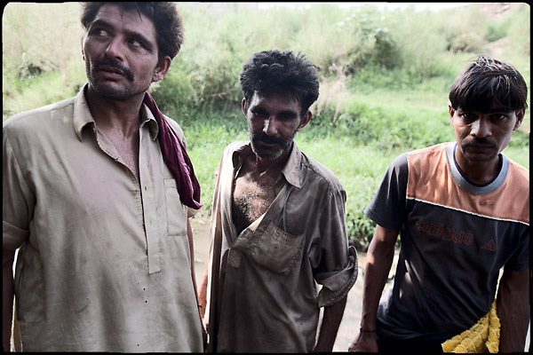 "Heroin smokers while waiting in between one dose and another of drug. Islamabad, Pakistan, on friday, August 29 2008.....""Pakistan is one of the countries hardest hits by the narcotics abuse into the world, during the last years it is facing a dramatic crisis as it regards the heroin consumption. The Unodc (United Nations Office on Drugs and Crime) has reported a conspicuous decline in heroin production in Southeast Asia, while damage to a big expansion in Southwest Asia. Pakistan falls under the Golden Crescent, which is one of the two major illicit opium producing centres in Asia, situated in the mountain area at the borderline between Iran, Afghanistan and Pakistan itself. .During the last 20 years drug trafficking is flourishing in the Country. It is the key transit point for Afghan drugs, including heroin, opium, morphine, and hashish, bound for Western countries, the Arab states of the Persian Gulf and Africa..Hashish and heroin seem to be the preferred drugs prevalence among males in the age bracket of 15-45 years, women comprise only 3%. More then 5% of whole country's population (constituted by around 170 milion individuals),  are regular heroin users, this abuse is conspicuous as more of an urban phenomenon. The substance is usually smoked or the smoke is inhaled, while small number of injection cases have begun to emerge in some few areas..Statistics say, drug addicts have six years of education. Heroin has been identified as the drug predominantly responsible for creating unrest in the society."""