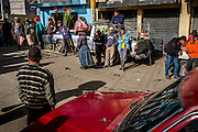 Temporary workers, many of them migrants from other parts of Guatemala, wait in the Almolonga market every morning hoping they will be selected by the land owners for a day of work. If they are unable to secure work for the day, they do not earn money.