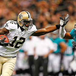 August 17, 2012; New Orleans, LA, USA; New Orleans Saints wide receiver Marques Colston (12) stiff arms away Jacksonville Jaguars safety Dwight Lowery (25) during the first half of a preseason game at the Mercedes-Benz Superdome. Mandatory Credit: Derick E. Hingle-US PRESSWIRE