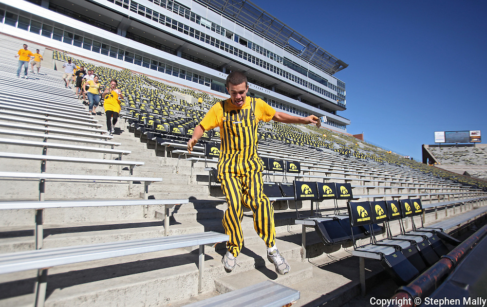 September 4 2010: A University of Iowa student runs for the front row as the gates open before the NCAA football game between the Eastern Illinois Panthers and the Iowa Hawkeyes at Kinnick Stadium in Iowa City, Iowa on Saturday September 4, 2010.