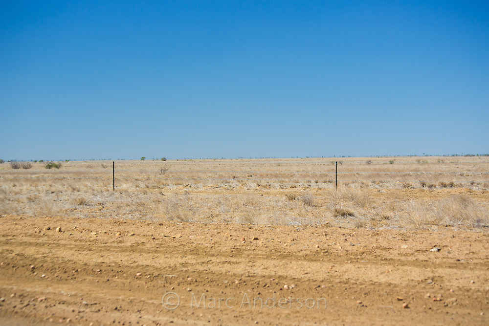 Dry, barren ground in drought conditions in outback Queensland, Australia