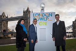 © Licensed to London News Pictures. 13/01/2020. LONDON, UK.  London, UK.  13 January 2020.  Sadiq Khan, Mayor of London (C), Shirley Rodrigues, Deputy Mayor for Environment and Energy (L), and Stuart Jackson, CEO of Octopus Energy (R), at the switch-on of a giant lightbulb in front of Tower Bridge to mark the launch of a brand new fair-priced, green energy company, available exclusively to Londoners to cut fuel bills and help make the capital a zero carbon city.    Photo credit: Stephen Chung/LNP