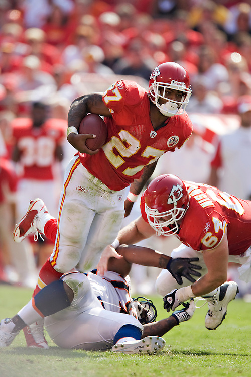 KANSAS CITY, MO - SEPTEMBER 28:   Larry Johnson #27 of the Kansas City Chiefs walks to the sidelines during a game against the Denver Broncos at Arrowhead Stadium on September 28, 2008 in Kansas City, Missouri.  The Chiefs defeated the Broncos 33-19.  (Photo by Wesley Hitt/Getty Images) *** Local Caption *** Larry Johnson