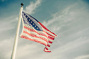 USA Flag in strong breeze at Plymouth, Massachusetts, USA