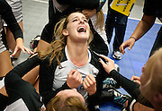 Sky View's Sierra Smith, center, screams in joy after Sky View's victory in the Utah State High School Volleyball 4A championship match versus Timpview in the UCCU in Orem, Saturday, Nov. 3, 2012.