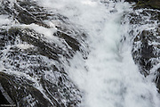 Water twists and turns and it cascades down Madcap Falls in Mt Rainier National Park.