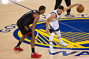 Golden State Warriors guard Stephen Curry (30) handles the ball against the Houston Rockets at Oracle Arena in Oakland, Calif., on March 31, 2017. (Stan Olszewski/Special to S.F. Examiner)