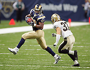 ST. LOUIS - SEPTEMBER 23:  Running back Steven Jackson #39 of the St. Louis Rams rushes for 97 yards and 2 touchdowns while avoiding a tackle by safety Steve Gleason #37 of the New Orleans Saints at the Edward Jones Dome on September 23, 2005 in St. Louis, Missouri. The Rams defeated the Saints 28-17. ©Paul Anthony Spinelli *** Local Caption *** Steven Jackson;Steve Gleason