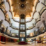 The ornate main foyer of the historic Gran Hotel De La Ciudad De Mexico on a corner of the Zocalo in the historic center of Mexico City.