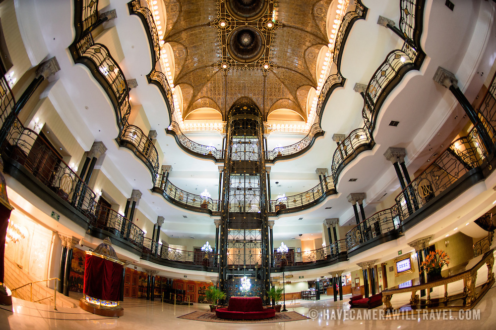 The ornate main foyer of the historic Gran Hotel De La Ciudad De Mexico on a corner of the Zocalo in the historic center of Mexico City.