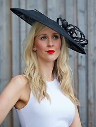 LIVERPOOL, ENGLAND - Friday, April 4, 2014: Laura Connolly of Gurnsey wearing a Jasper Conran hat and French Connection dress during Ladies' Day on Day Two of the Aintree Grand National Festival at Aintree Racecourse. (Pic by David Rawcliffe/Propaganda)