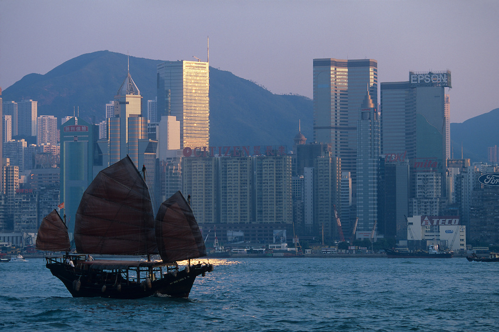 China, Hong Kong, Sailing junk in Hong Kong Harbour at sunset