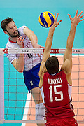 (L) Julien Lyneel from France attacks against (R) Dmitriy Ilinykh from Russia during the 2013 CEV VELUX Volleyball European Championship match between Russia v France at Ergo Arena in Gdansk on September 25, 2013.<br /> <br /> Poland, Gdansk, September 25, 2013<br /> <br /> Picture also available in RAW (NEF) or TIFF format on special request.<br /> <br /> For editorial use only. Any commercial or promotional use requires permission.<br /> <br /> Mandatory credit:<br /> Photo by &copy; Adam Nurkiewicz / Mediasport