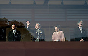 Emperor Akihito of Japan with his wife, Empress Michiko flanked by their two sons, Crown Prince Naruhito on the left and Prince Akishono on the right, waves to the  crowd of well wishers from behind bullet proof glass on a balcony of the Chowaden reception hall in the Imperial Palace during Emperor Akihito's traditional birthday address on December 23rd 2008 in Tokyo. Japan