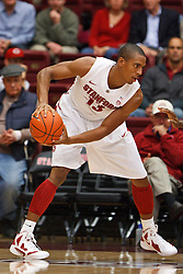 Nov 28, 2011; Stanford CA, USA;  Stanford Cardinal forward/center Josh Owens (13) holds the ball against the Pacific Tigers during the first half at Maples Pavilion. Stanford defeated Pacific 79-37. Mandatory Credit: Jason O. Watson-US PRESSWIRE