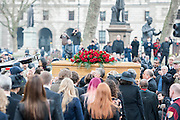 The coffin leaves under the Watchful eye of Nelson Mandela. Tony Benn's funeral at 11.00am at St Margaret's Church, Westminster. His body was brought in a hearse from the main gates of New Palace Yard at 10.45am, and was followed by members of his family on foot. The rout was lined by admirers. On arrival at the gates it was carried into the church by members of the family. Thursday 27th March 2014, London, UK. Guy Bell, 07771 786236, guy@gbphotos.com