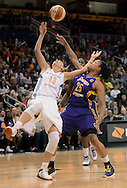 Sep 21, 2013; Phoenix, AZ, USA; Phoenix Mercury forward Penny Taylor (13) is defended by the Los Angeles Sparks guard Marissa Coleman (25) in the first half during Game 2 of a WNBA basketball Western Conference semifinal series at US Airways Center. Mandatory Credit: Jennifer Stewart-USA TODAY Sports