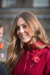© Licensed to London News Pictures. 07/11/2013.  The Duchess of Cambridge met members of the Armed Forces today at Kensington Palace today as the Royal British Legion aimed to collect a million pounds in one day.  The Royal couple then popped onto a Poppy bus and met with former and serving soldiers at High Street Kensington.      Photo credit: Alison Baskerville/LNP