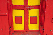 Red and Yellow entrance to a building in Port Louis.