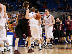 Wheeling Central forward Adam Campbell (44) celebrates as the team edges closer to victory during a semi final round game at the Charleston Civic Center.