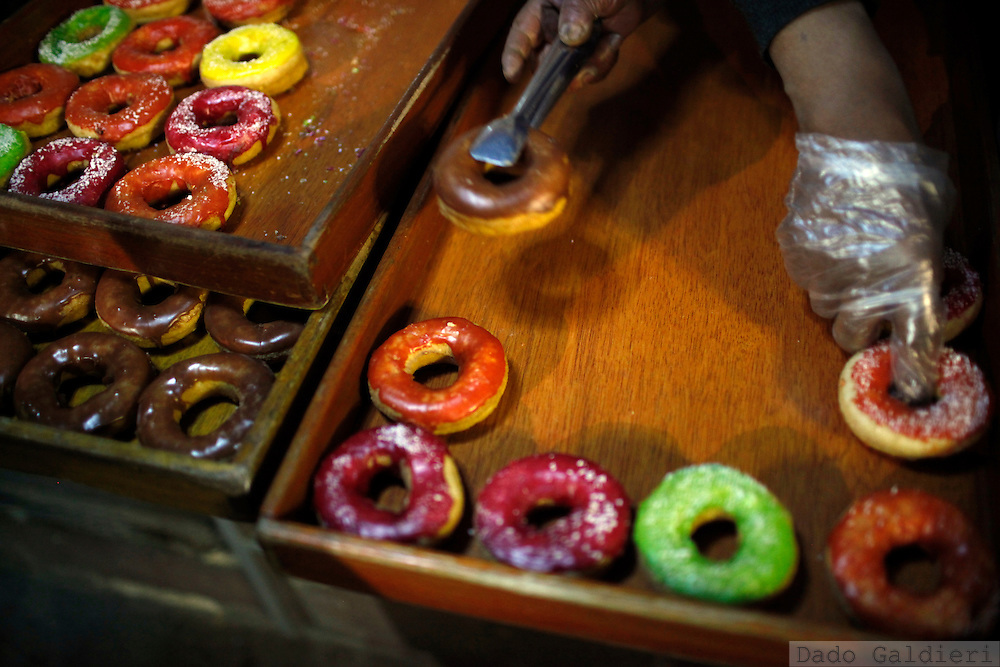 Homemade donuts are displayed at a food stall in La Paz, Tuesday, July 13, 2010. Junk food in Bolivia is not only a matter of big food chains. With prices barely exceeding USD1,00 for a complete meal, it has become the choice of lower classes which comprise most of the population on the South America's poorest country.
