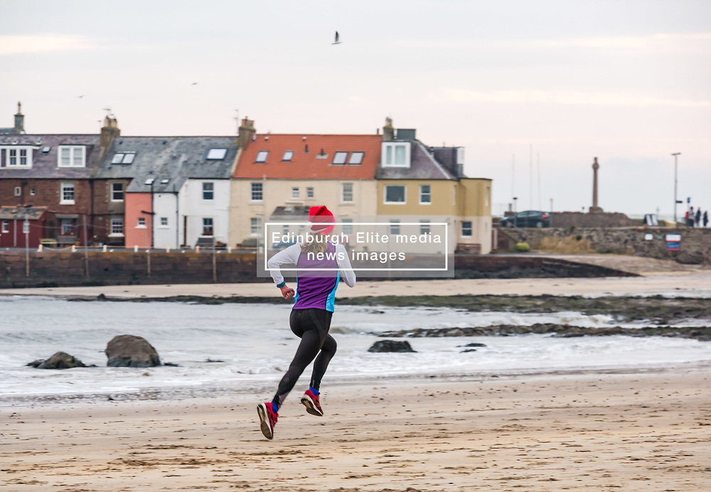 Pictured: Santa Beach Run on the scenic East Lothian coast. This new event is aimed at athletes, casual runners and families. It is hosted by Project Trust with proceeds enabling local school leavers to spend a year volunteering in India/Honduras to teach at a school with few teaching materials. The fastest woman running back to the finishing position across West Bay beach. 15 December 2018  <br /> <br /> Sally Anderson | EdinburghElitemedia.co.uk