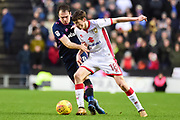 Milton Keynes Dons midfielder Conor McGrandles (18) battles with Portsmouth striker Brett Pitman (8) during the EFL Sky Bet League 1 match between Milton Keynes Dons and Portsmouth at stadium:mk, Milton Keynes, England on 10 February 2018. Picture by Dennis Goodwin.