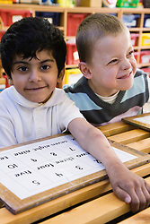 Children with physical and learning disabilities in a  lesson,