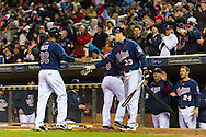 Aaron Hicks #32 of the Minnesota Twins celebrates with teammates Eduardo Escobar #5 and Justin Morneau #33 after scoring during a game against the Los Angeles Angels on April 16, 2013 at Target Field in Minneapolis, Minnesota.  The Twins defeated the Angels 8 to 6.  Photo: Ben Krause