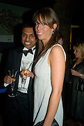 Nishan Srinivasan and Angelica Dawson. Save the Children's Festival of Trees Gala dinner. Natural History Museum. London. 4 December 2007. -DO NOT ARCHIVE-© Copyright Photograph by Dafydd Jones. 248 Clapham Rd. London SW9 0PZ. Tel 0207 820 0771. www.dafjones.com.