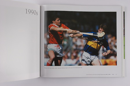 Cork's Denis Walsh catches Tipperary's Nicholas English on the nose in the 1990 Munster Final.