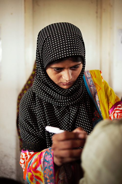 Naheed Iram, a lady health worker at the Government Health Clinic in the village of Babrio Jat, Thatta, Sindh, Pakistan on July 2, 2011. She is 28 years old and a Merlin nutrition Specialist.