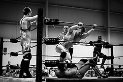 Classy Mason Myles pins Trey Williams in the corner as teammate No Comparrison Joe Harrison and opponent Jon Williams, opposite corner, watch during Old School Championship Wrestling Sunday, March 13, 2016 at the Hanahan Sports Complex. Paul Zoeller/Staff