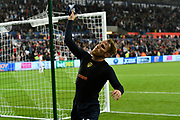 Samuel Saiz (14) of Leeds United throws his shirt to the Leeds fans at full time after a 2-2 draw during the EFL Sky Bet Championship match between Swansea City and Leeds United at the Liberty Stadium, Swansea, Wales on 21 August 2018.