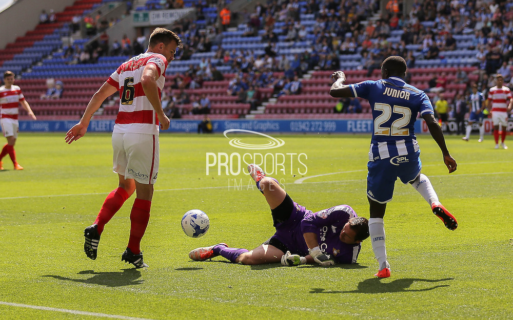 O'Donnell saves from Junior during the Sky Bet League 1 match between Wigan Athletic and Doncaster Rovers at the DW Stadium, Wigan, England on 16 August 2015. Photo by Simon Davies.
