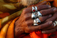 """India, Maharashtra, Nasik, 2007. In the soft light of early morning, the hands of a """"sadhu"""" or holy man, relax in meditation."""
