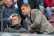 Hibs manager Paul Heckingbottom (standing) and his assistant coach Robbie Stockdale watch from the stand before the Ladbrokes Scottish Premiership match between Heart of Midlothian and Kilmarnock at Tynecastle Stadium, Gorgie, Scotland on 4 May 2019.
