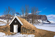 Quaint turf church built 1789 at Nupsstaour by promontory Lomagnupur in South Iceland