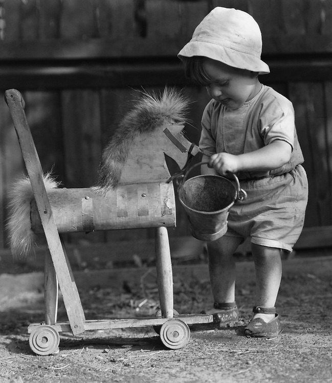 Child with Toy Horse, England, 1932