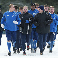 St Johnstone Training...03.02.03     Billy Kirkwood and Tommy Lovenkrands lead the  squad on a run this morning during training ahead of a replay against Airdre tomorrow night .<br />