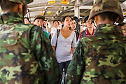 25 MAY 2014 - BANGKOK, THAILAND: Shoppers at a Bangkok shopping mall in the Ratchaprasong area try to get past soldiers who secured the area in face of growing protests. Public opposition to the military coup in Thailand grew Sunday with thousands of protestors gathering at locations throughout Bangkok to call for a return of civilian rule and end to the military junta.     PHOTO BY JACK KURTZ