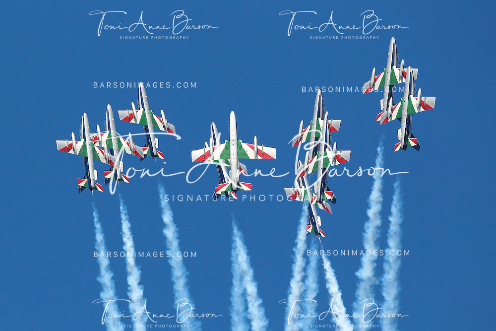 "SALON-DE-PROVENCE, FRANCE - MAY 26:  The Frecce Tricolori demonstration flight during the  60th Anniversary Celebration of The ""Patrouille de France"", the legendary French flight demonstration team at its home base 701 on May 26, 2013 in Salon-de-Provence, France.  (Photo by Tony Barson/Getty Images)"