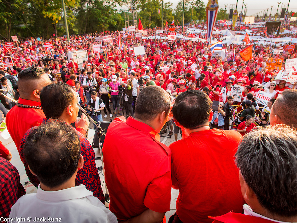 10 MAY 2014 - BANGKOK, THAILAND: Red Shirt leaders stand on a stage in Bangkok in front of a crowd of thousands of supporters. Thousands of Thai Red Shirts, members of the United Front for Democracy Against Dictatorship (UDD), members of the ruling Pheu Thai party and supporters of the government of ousted Prime Minister Yingluck Shinawatra are rallying on Aksa Road in the Bangkok suburbs. The government was ousted by a court ruling earlier in the week that deposed Yingluck because the judges said she acted unconstitutionally in a personnel matter early in her administration. Thailand now has no functioning government. Red Shirt leaders said at the rally Saturday that any attempt to impose an unelected government on Thailand could spark a civil war. This is the third consecutive popularly elected UDD supported government ousted by the courts in less than 10 years.    PHOTO BY JACK KURTZ