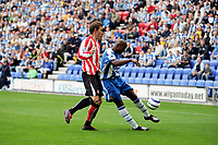 Photo: Peter Phillips.<br /> Wigan Athletic v Sunderland. The Barclays Premiership.<br /> 27/08/2005<br /> Dean Whitehead keeps a close eye on Jason Roberts