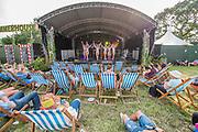 Pilton, Somerset, UK. 29th June 2019. Dancers entertain at the Summerhouse - he 2019 Glastonbury Festival, Worthy Farm. Glastonbury.