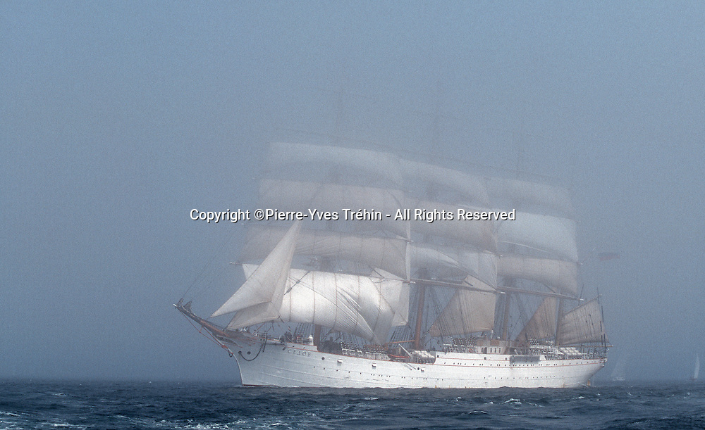 The Sedov, russian tall-ship four-masted barque leaving Brest bay in the fog